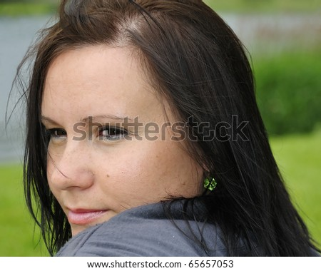 Dreaming lady outdoor portrait - stock photo