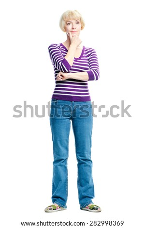 Dreaming lady. Thoughtful middle aged woman holding hand on chin and looking at camera while standing isolated on white background - stock photo