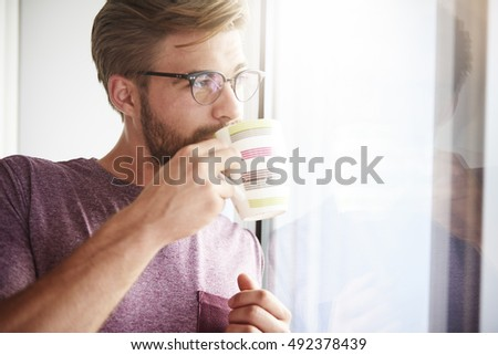 Dreaming man drinking fresh coffee