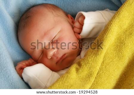 dreaming newborn baby - 3 days old baby sleeping - stock photo