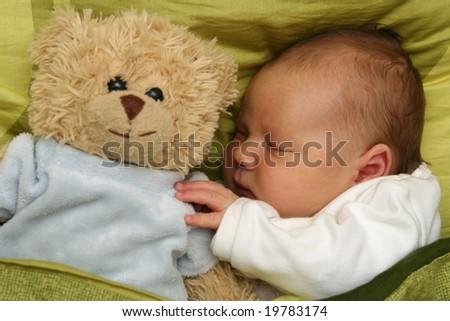 dreaming newborn baby - 3 weeks old baby sleeping - stock photo