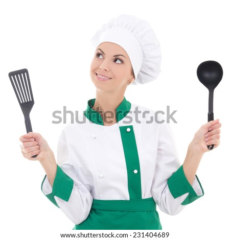 dreaming woman in green chef uniform with kitchen tools isolated on white background - stock photo