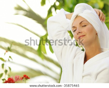 Dreaming young woman after bath - stock photo