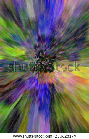 Dreamlike pointillist abstract with radial blur and flowery colors for themes of origins, centrality, nature and the outdoors - stock photo