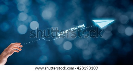 Dreams come true concept. Hand throw a paper plane symbolizing dreams. Wide banner composition with bokeh background.