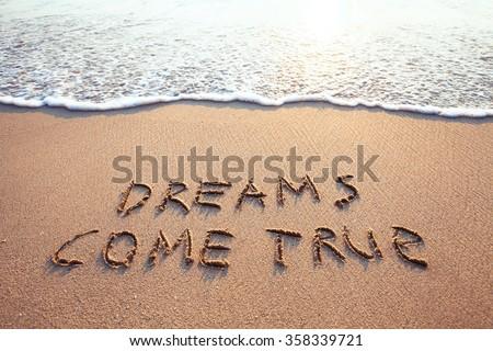 dreams come true, concept on the sand - stock photo