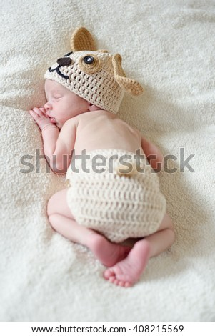 dreams of a tiny newborn on the bed - stock photo