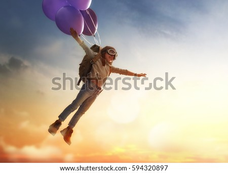 Child Flying On Balloons Against The Backdrop Of A Sunset