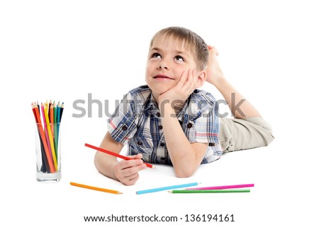 dreamy child boy with pencils on white background - stock photo