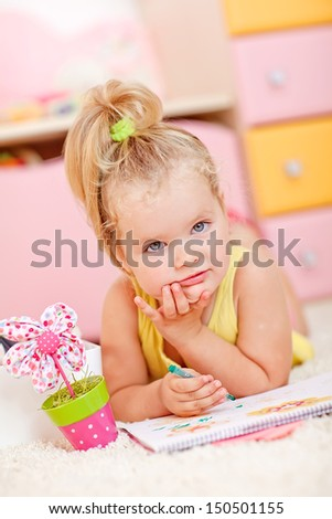 dreamy child girl with pencils - stock photo