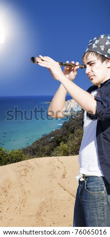 Dreamy Fantasy Scene Of A Man In Pirate Costume Standing On A Deserted Island Looking Through A Monocular Navigation Instrument In Search Of Dreams - stock photo
