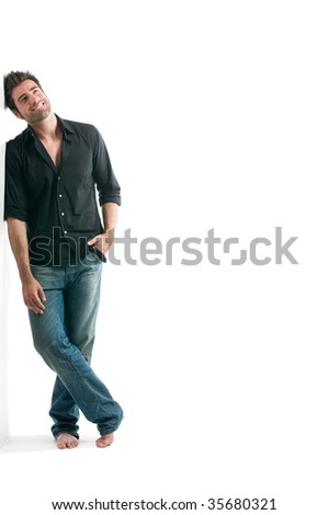 Dreamy latin man looking up with copy space for your text isolated on white background - stock photo