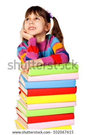 Dreamy Little girl holding pile of books. Isolated over white - stock photo