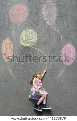 Dreamy little girl l flying with painted balloons. Happy childhood concept. - stock photo