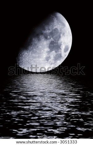 Dreamy photo of the moonrise over the water - stock photo