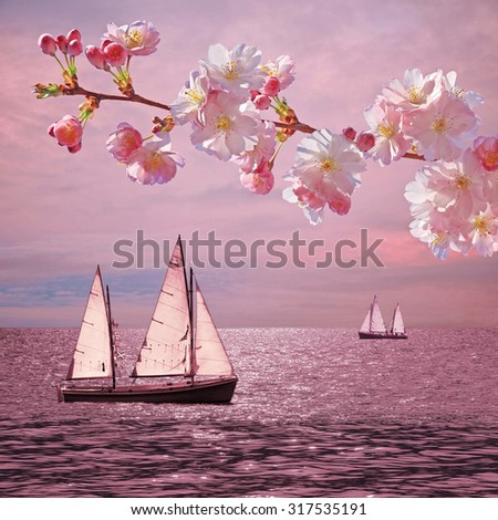 dreamy sunset ocean with sailboats, blooming cherry twig - stock photo
