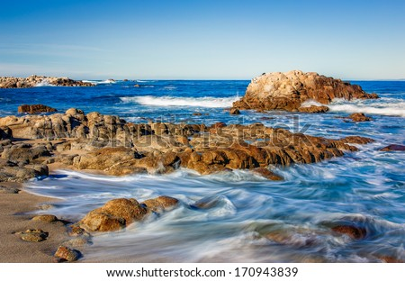 Dreamy Waves Coming Ashore in Pacific Grove, California - stock photo