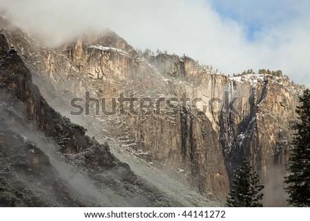 Dreamy Winter Landscape of Clouds Climbing up El Capitan in Yosemite National Park, California. - stock photo
