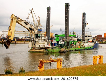 Dredger, dredging vessel in river and harbor - stock photo