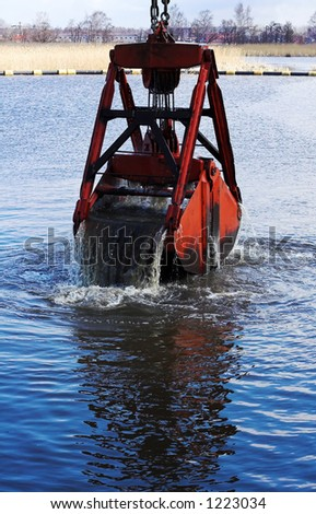 Dredging a harbour - stock photo