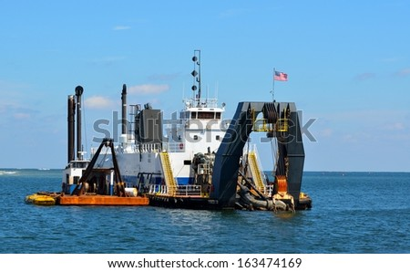 Dredging on the ocean inlet of St. Augustine, Florida. - stock photo