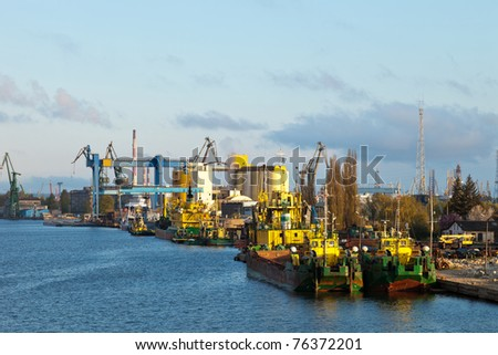 Dredging ship berthed at the wharf port in Gdansk, Poland. - stock photo