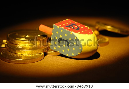 Dreidel and Gelt - Hanukkah Related Objects - Jewish - stock photo