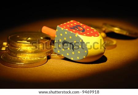 Dreidel and Gelt - Hanukkah Related Objects - Jewish - stock photo