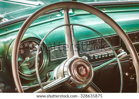 DREMPT, THE NETHERLANDS - OCTOBER 1, 2015: Retro styled image of the interior of a classic 1951 Dodge Coronet in Drempt, The Netherlands - stock photo