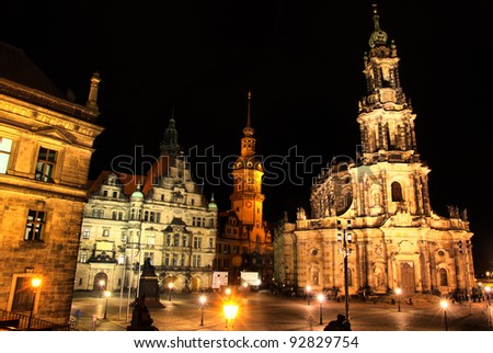Dresden, Germany at night. View to Schlossplatz and St. Trinitatis Cathedral - stock photo