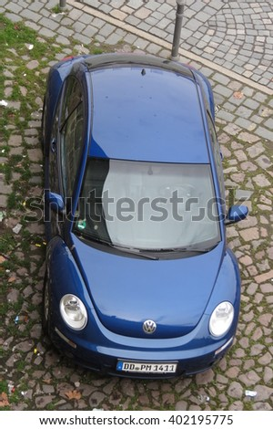 DRESDEN, GERMANY - CIRCA MARCH 2016: blue Volkswagen New Beetle car parked in a street of the city centre - stock photo