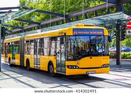 DRESDEN, GERMANY - JULY 20, 2014: Articulated city bus Solaris Urbino 18 in the city street. - stock photo