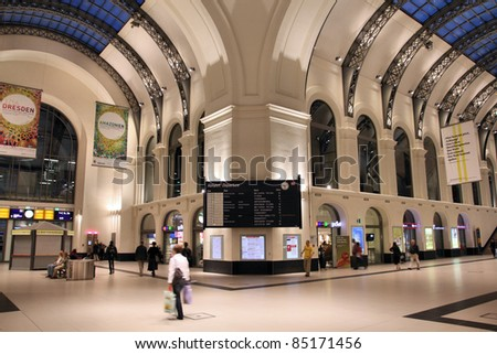DRESDEN, GERMANY - JULY 24: Travelers on July 24, 2010 in Dresden, Germany. Dresden Central opened in 1898 is now a major station with 600 daily trains. - stock photo