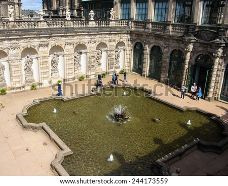 DRESDEN, GERMANY - JUNE, 20th, 2014: Side-top view of Nymphebad fountain in Zwinger palace, famous landmark of Dresden, Germany, during sunny day on 20th June 2014.