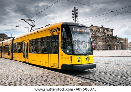 DRESDEN, GERMANY- JUNE 20, 2016:  Yellow articulated tram SachsenTram  at the city street