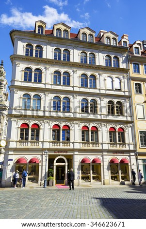 DRESDEN, GERMANY - SEPTEMBER 19, 2015: The house at New Market Square (Neumarkt), the central and culturally significant section of the inner city, it is a place often visited by many tourists - stock photo
