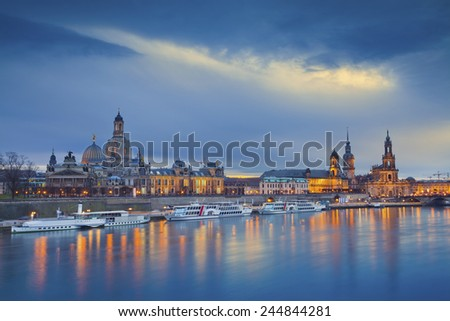 Dresden. Image of Dresden, Germany during twilight blue hour with Elbe River in the foreground. - stock photo