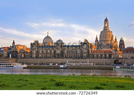 dresden skyline with river elbe and boats at sunset - stock photo