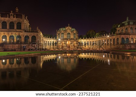Dresden Zwinger palace panorama with illumination at night and water reflection, Germany  - stock photo