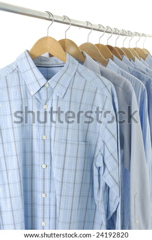 Dress shirts on wooden hangers - stock photo