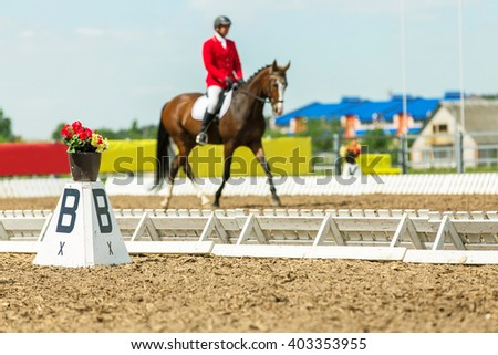 Dressage rider at competition. - stock photo