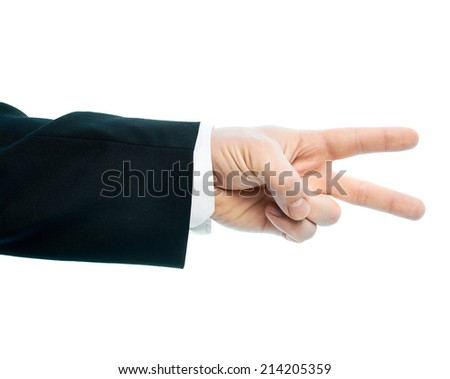 Dressed in a business suit caucasian male hand gesture of a two fingers victory sign, high-key light composition isolated over the white background - stock photo