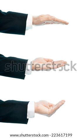 Dressed in a business suit caucasian male hand gesture of an opened palm, high-key light composition isolated over the white background, set of three images - stock photo