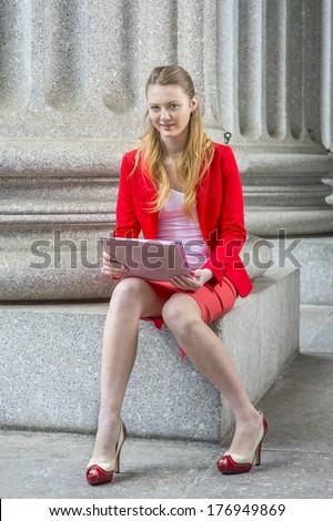 Dressing in a red blazer, white under wear, a red skirt, open toes