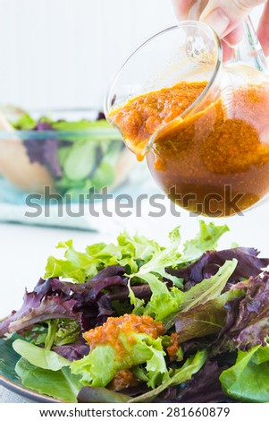Dressing made with carrots, onions, oil, vinegar, shoyu and mirin