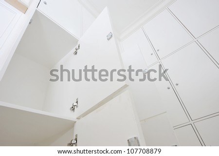dressing room with white lockers. - stock photo