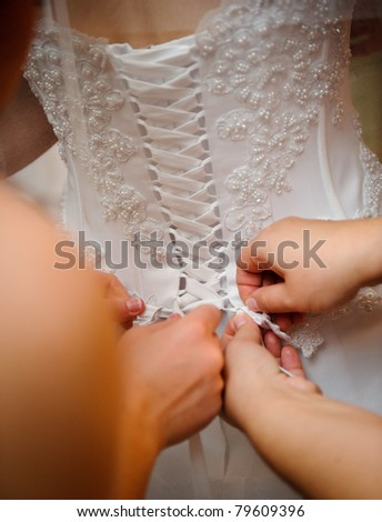 Dressing the bride - stock photo