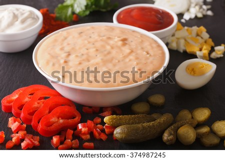 Dressing thousand islands surrounded by ingredients on a table close-up. horizontal - stock photo