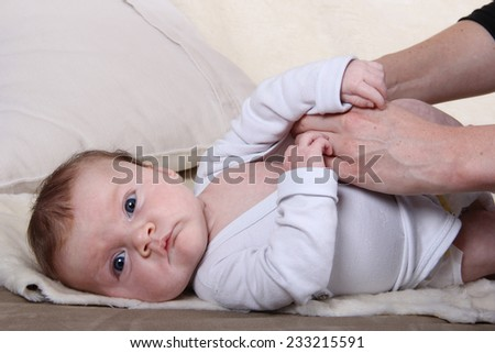dressing up a baby - stock photo
