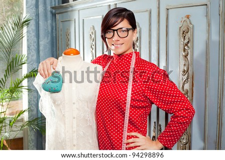 Dressmaker with mannequin as professional fashion designer - stock photo